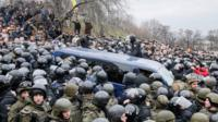 Mr Saakashvili's was detained in a car that got swamped by supporters and police