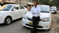 Mumbai driver Kuldeep Singh Barswal in front of his taxi