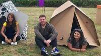 People in cardboard tents