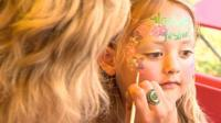 A girl has her face painted
