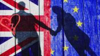 Couple in shadow with UK and EU flag in background