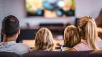 A family watch television together