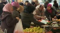 People at fruit stall in Molenbeek