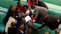 Fighting on the benches in Uganda parliament