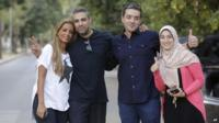 Mohammed Fahmy (second left) and his wife Marwa Omara (far left) and Baher Mohamed (second right) and his wife Jehan Rashed (far right)