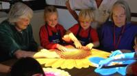 Pupils play a light game with care home residents