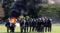 Riot police officers clash with demonstrators during a protest against President Michel Temer and the latest corruption scandal to hit the country, in Brasilia, Brazil, May 24, 2017.
