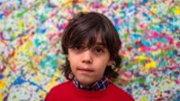 Mikail Akar, seven, says painting can be exhausting