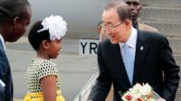 Ban Ki-moon shakes hands with a Burundian girl