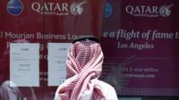 A man stands outside Qatar Airways office in Riyadh, Saudi Arabia, June 5, 2017