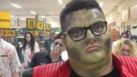 Supermarket worker dressed as Michael Jackson