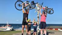 Jones family holding bikes
