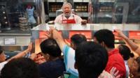 Costco employee yells at customers