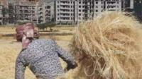 A farmer near a housing development in Addis Ababa