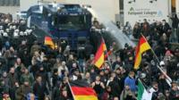 Police fire water cannon at protesters in Cologne