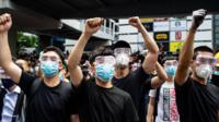 Protesters in masks and goggles chant slogans outside the Legislative Council in Hong Kong on June 12, 2019