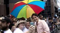 Prime Minister Justin Trudeau poses for a photo gay pride march in Toronto on 3 July
