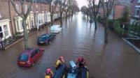Flooded tree-lined street