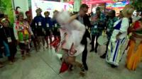 A dancer flips into the BBC's Aaron Heslehurst