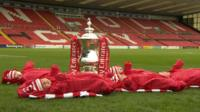 Babies next to FA Cup