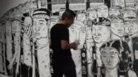 Singapore street artist with his artwork
