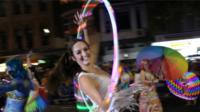 woman dances with a hulk hoop during the annual Sydney Gay and Lesbian Mardi Gras parade in Sydney, Australia