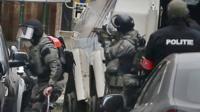 Belgian police take part in a raid in Molenbeek, Brussels. Photo: 18 March 2016