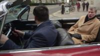 Ted Malloch rides round Westminster in cadillac