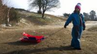 Amelia picks up broken sledges