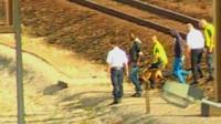 Migrants are escorted off Eurotunnel tracks