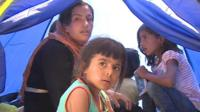 Refugees at a detention centre in Lesbos