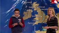A school child and Sarah Keith-Lucas in front of a weather map