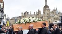 Pallbearers carry Stephen Hawking's coffin