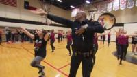 Officer dancing at school