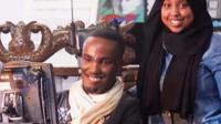 Abdi Omar in a wheelchair with wife Maria