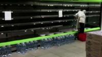 Empty shelves in supermarket