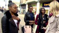 Young women talk to reporter