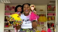 Khulile Vilakazi Ofosu with her dolls
