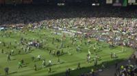 Fans invade Hampden pitch