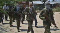 Al-Qaeda linked al-Shabab recruits walk down a street in the Deniile district of the Somalian capital, Mogadishu