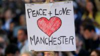 """Peace + Love Manchester"" sign"