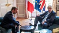 UK PM Boris Johnson, making a joke with his foot on the table at a meeting with President Macron