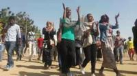 Protesters chant and clp their hands in Khartoum