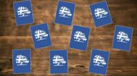 Playing cards with Tory logo on them
