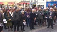 People in Caernarfon observing the Aberfan minute's silence
