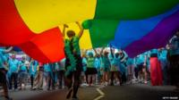 People take part in the annual Pride in London parade