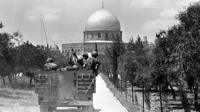 Israeli soldiers advance towards the Dome of the Rock
