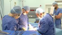 Surgical team carrying out bladder replacement surgery