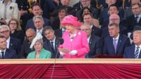 Macron, May and Trump listen as the Queen commemorates the D-Day landings