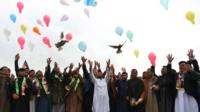 Youth release balloons and pigeons as they celebrate the reduction in violence, in Jalalabad on 28 February
